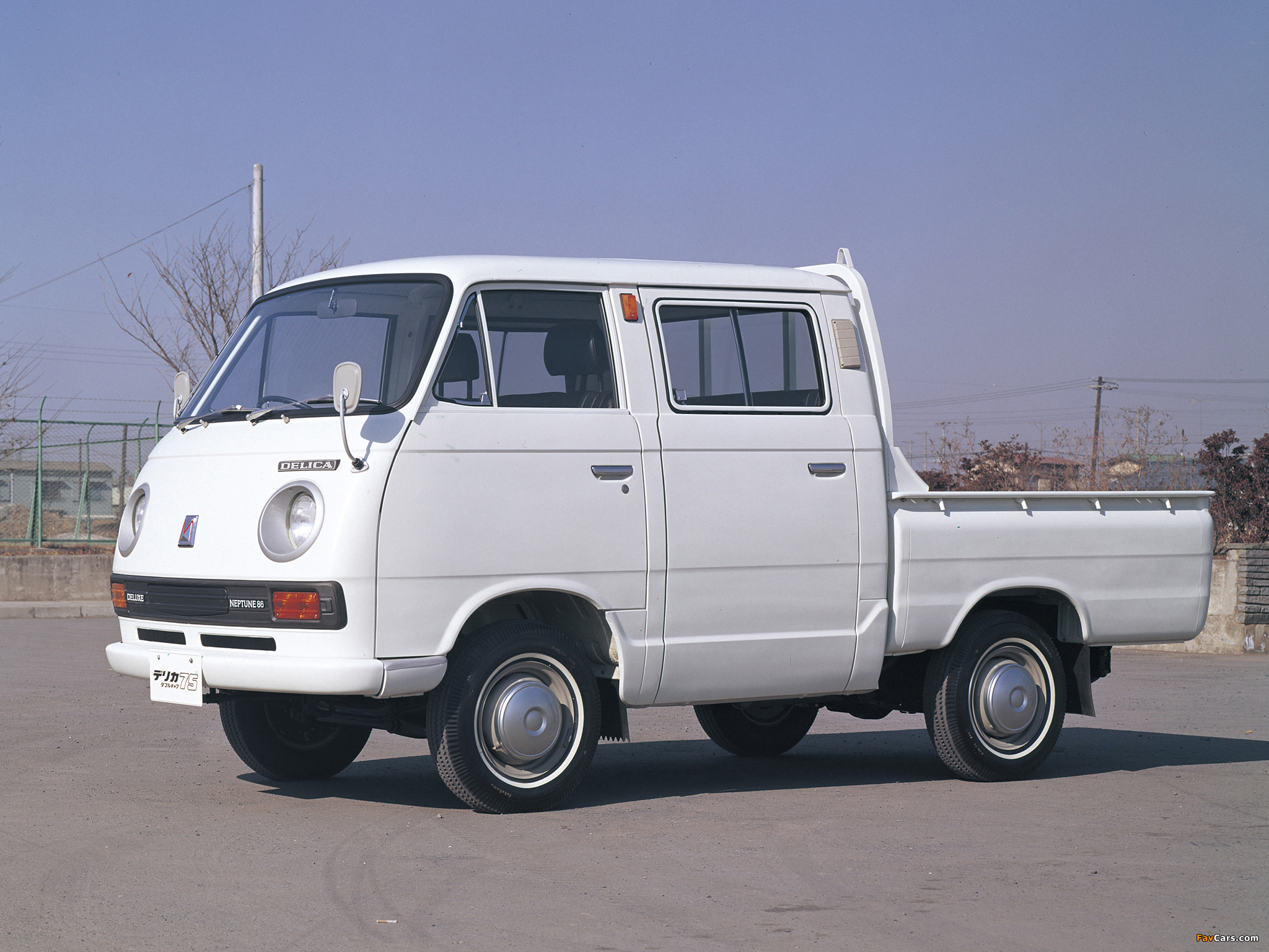 Mitsubishi did do such: the Delica Pickup Double Cab from the 1970s.