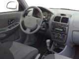 Photos of Hyundai Accent 5-door 2003–06