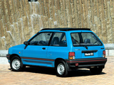 Photos of Mazda 121 3-door (DA) 1987–91
