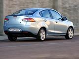 Mazda2 Sedan ZA-spec (DE2) 2010–12 photos