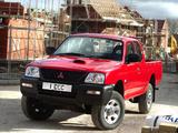Photos of Mitsubishi L200 4Work Club Cab UK-spec 2005–06