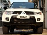 Photos of Mitsubishi L200 Barbarian Black 2012