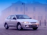Photos of Mitsubishi Mirage 3-door 1995–2000