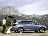 Opel Astra Sports Tourer (J) 2010–12 pictures