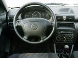 Photos of Opel Astra 3-door (F) 1994–98