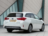 Photos of Toyota Auris Touring Sports Hybrid UK-spec 2013